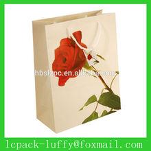 little white drawstirings red roses flowers paper shopping gift bag for customer's luxury goods