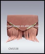 Dusty pink fashion suede tassel ladies clutch handbag with metal trim