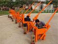 Manual de tierra comprimida de la máquina de bloque pequeño manual de bloqueo de cemento de ladrillo de la máquina/manual de cenizas volantes de ladrillo que hace la máquina qmr 2-40