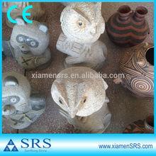 Garden stone owl sculpture