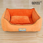Bright orange dog bed with small pillow insides