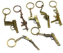 2015 spring imitation gun gold charm key chain promotion gift