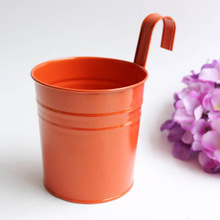 Colorful metal hanging flower bucket