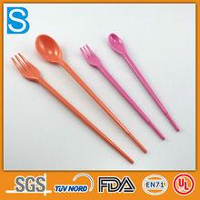 Colorful plastic long-handled dessert spoon