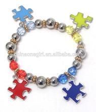 ball and puzzle piece charm autism theme stretch bracelet