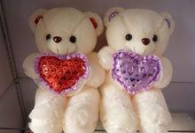 white huggy bear holding red heart