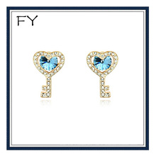 Cluster crystal key shaped earrings light sapphire
