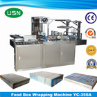 Automatic newspaper wrapping machine