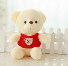white stuffed plush bear with red T-shirt