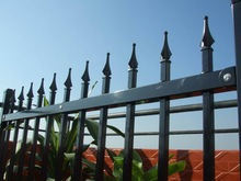 Ornamental iron fence with spears