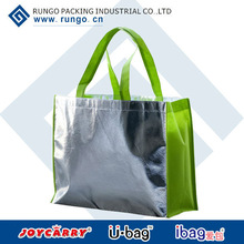 Silver metallic non woven gift tote bag with green handle and sides