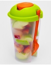 Plastic fruit salad cup with fork and sauce cup