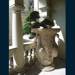 Archaistic sculptured limestone planter and pots