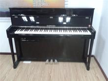 Charming white baby grand piano