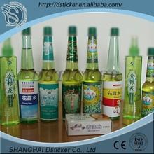 Brand new waterproof paper sticker label on clear glass bottle