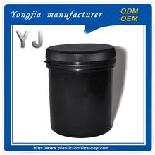 flat round black plastic sealed jar