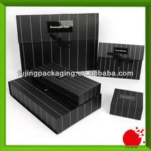 Black bespoke package paper bag with ribbon tie
