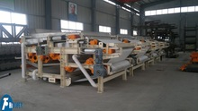 High efficiency continous operation belt filter press for paper industry