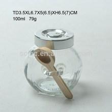 Mini glass storage jar with plastic lid or metal lid and wood spoon