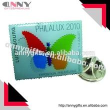 Postage stamp shape souvenir badge