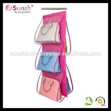Pink hanging handbag organizer compartment