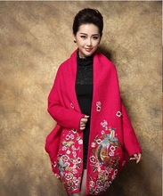 Woman's fashion and elegant embroidery wool coat in bright pink and bright blue color