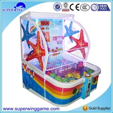 Family parents with kids play together basketball game machine in game center