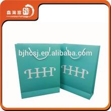 Luxury design logo printed shopping paper bag wholesale