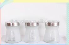 glass storage jar with sandy