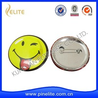 faces badges smiling pin