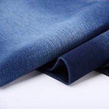Shrink resistant spandex/cotton denim fabric
