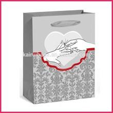 In stock paper bag fashion design wedding favors