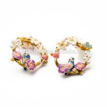 Della jewelry fashion colorful birdlike and Parisian scene hoops on sale