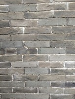 Grey old brick in 1910-1940s building brick loess material history feeling