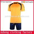 มาเลเซียjerseyฟุตบอลกีฬาสีเหลืองและสีแดงjerseyฟุตบอล