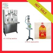 Semi automatic pneumatic oil filling packing machine