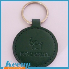 chinese promotional gifts custom embossed logo round leather key chain wholesale