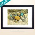 realista de pintura al óleo de piedra de colores en el mar