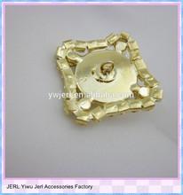 metal crest button