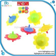 cheap mini plastic spinning top for children