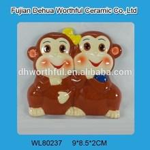 Ceramic souvenir fridge magnet with monkey figurine