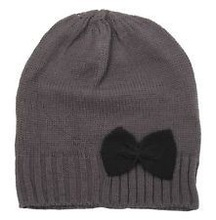 children knit winter hat with bow