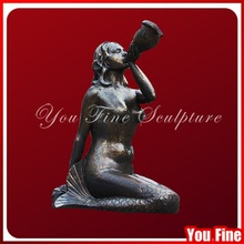 Beautiful woman sitting bronze carving mermaid