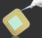 Adhesive foam wound dressing