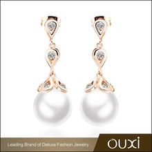 OUXI antique zircon fancy pearl stud peacock design earrings