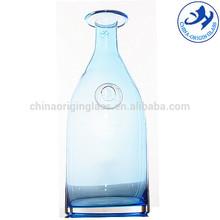 Scissors cut hand blown blue colour glass water bottle