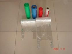 HDPE plastic t-shirt shopping bag on roll