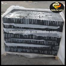 Black rough granite blocks