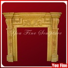 Antique Yellow Carved Stone Fireplace With Flowers