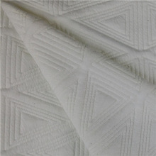 2015 hot selling knitted quilt jacquard fabric in solid dyeing for women garment